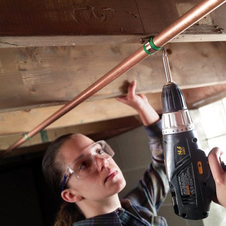 <b>Wrap pipes in adhesive-backed felt</b></br> Running hot water can cause copper pipes to expand and grind against pipe hangers and joists. So pick up some adhesive-backed felt at the hardware store and cut it into strips. Then remove each hanger and wrap the pipe before refastening the hanger.