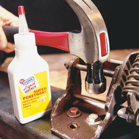 <b>Then use oil and a hammer to loosen</b></br> When the bolt is cool enough to touch, squirt penetrating oil (it comes in a spray can or squirt bottle) on and around it—and on the nut if it's accessible. Be careful, that stuff is flammable. Tap the end of the bolt a half-dozen times with a hammer to help loosen the threads and allow the oil to penetrate. Wait another minute or so for the oil to work, and then use your wrench.