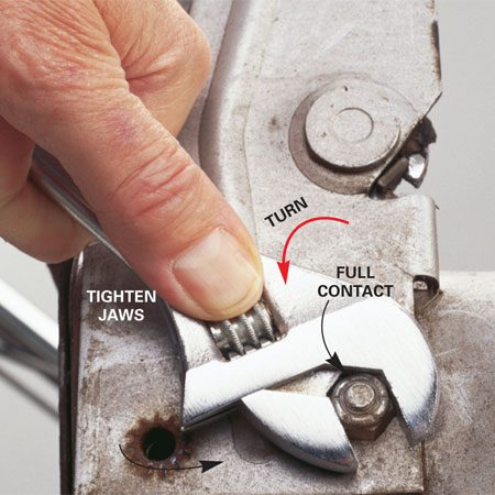 <b>Use an adjustable wrench correctly</b></br> An adjustable wrench isn't the ideal tool for loosening stuck fasteners because it can round over the head, making matters worse. But if an adjustable wrench is your only option, here's your best shot at preserving the shoulders on the nut or bolt head: Slide on the wrench all the way, so there's full contact at the back of the jaws. Then tighten the wrench thumbscrew so there's no play at all in the jaws. Always turn the wrench handle toward the lower jaw, never away from it.