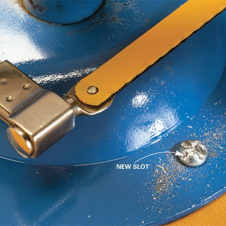 <b>Cut a new slot with a hacksaw</b></br> Use a hacksaw to cut a new slot at a right angle to the old one. For big screws, put two blades in your hacksaw, right next to each other, and cut a wider slot so you can use a big screwdriver. This is also a great way to get a grip on the head of a stuck carriage bolt, which has no slot or flats.