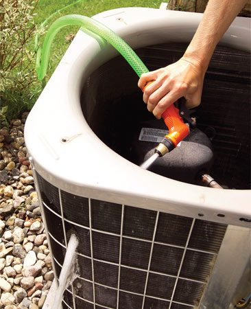 <b>Photo 5: Clean the fins</b></br> Spray the fins using moderate water pressure from a hose nozzle. Direct the spray from the inside out. Reinstall the fan.