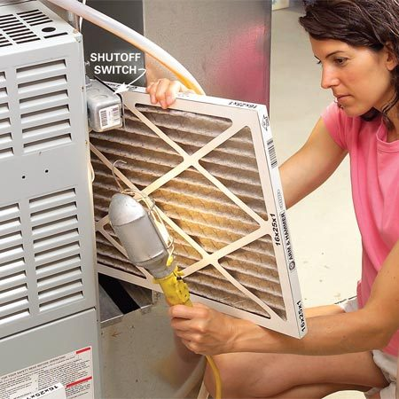 <b>Photo 7: Check the furnace filter</b></br> Turn off the power to the furnace at a nearby switch or at the main panel. Then pull out the furnace filter and check it for dirt buildup. Change it if necessary.