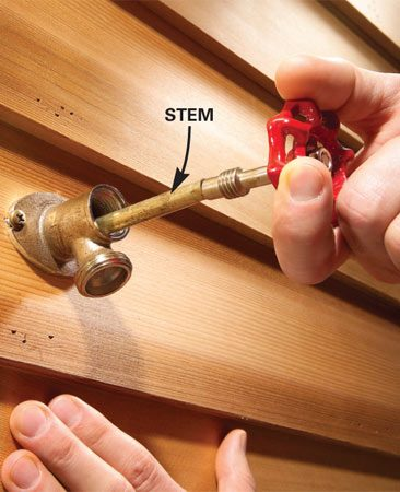 <b>Photo 2: Remove the stem</b></br> Put the knob back on and turn it counterclockwise to remove the valve stem. Some stems don't need to be unscrewed but come straight out with a firm tug.