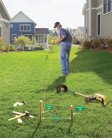 <b>Mark the fence line</b></br> Drive stakes and run string to mark your fence line.