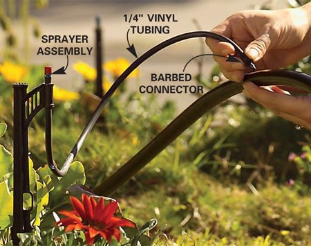 <b>Photo 5: Push in the connector</b></br> Press a barbed connector into the hole in the 1/2-in. tubing. If the 1/4-in. tubing isn't already attached, add a length of 1/4-in. tubing to reach your dripper, sprayer or sprinkler location.