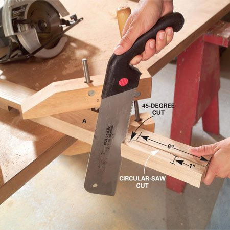 <b>Photo 2: Cut the handles</b></br> Cut the grips on the bottom edge of each handle with a circular saw (half-laps on the handles face inside). Then finish the cuts with a handsaw.