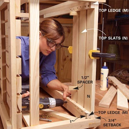 <b>Photo 10: Attach top ledges</b></br> Glue and screw the top ledges (M) to the handles with 2-in. screws. Attach the three fixed top slats (N) from underneath with 1-1/4-in. screws.