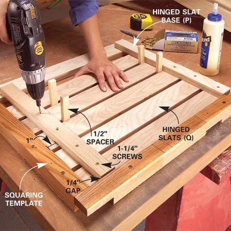 <b>Photo 11: Build the hinged top</b></br> Assemble the hinged top slat section in the squaring template to keep it square. Space the slats (Q) 1/2 in. apart and drive 1-1/4-in. screws.
