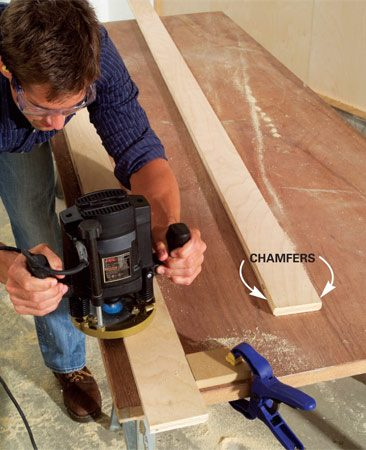 <b>Photo 4: Chamfer 3 edges </b><br/>Cut three 45-degree chamfers 1/8 in. deep on each rail using a router and chamfer bit.
