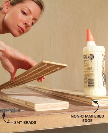 <b>Photo 5: Add the plywood spacer </b></br> Glue 2-1/2-in.-wide strips of 1/4- in. plywood to the back of each rail, even with the non-chamfered edge. Tack the strip into place with a pair of 3/4-in. brads every 12 in.