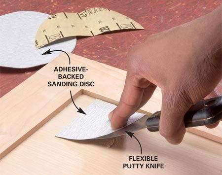 <b>Sand tight corners</b><br/>Sandpaper wrapped around the blade of a putty knife reaches into and smooths square corners.