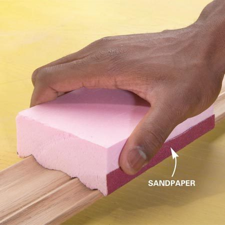 <b>Photo 3: Adhere sandpaper to the block</b></br> Coat the foam block and the back of the sandpaper with spray adhesive. Carefully stick the sandpaper to the block and sand the molding.