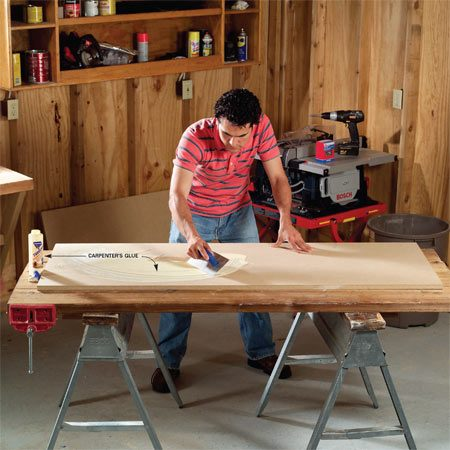 <b>Photo 1: Two slabs of 3/4-in. particleboard make up the foundation.</b></br> Cut two pieces of 3/4-in. particleboard a bit longer and wider than your actual desk size. Spread carpenter's glue onto the top side of the lower piece using a 1/8-in. notched trowel. Make sure the entire top is covered with glue, especially the edges.