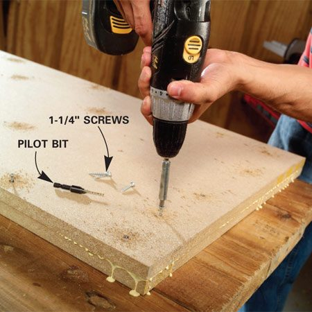<b>Photo 2: Glue and screw the two pieces together</b></br> Predrill, glue and screw the top piece onto the lower using 1-1/4-in. wood screws. Keep your screws about 2 in. in from the edge and drive them every 6 in. across the entire surface.