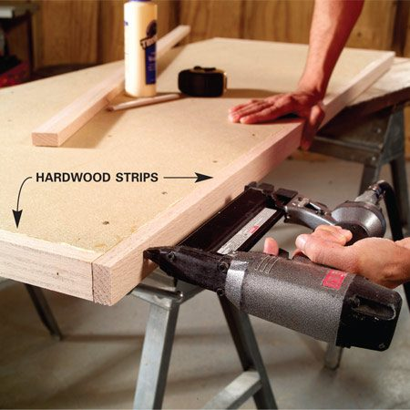 <b>Photo 4: Attach hardwood edging</b></br> Cut, glue and nail 3/4-in.- thick hardwood strips to the sides of your top. Rip these trim pieces 1/16 in. wider than the thickness of your top.