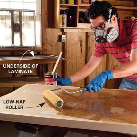 <b>Photo 7: Spread the contact cement </b></br> Vacuum the top until it's free of dust. Roll on contact cement with a low-nap roller, making sure to cover the whole area. <em>Wear a respirator and have plenty of ventilation.</em> Roll the contact cement onto the backside of the plastic laminate as well. Let the adhesive dry for 30 minutes, until it's no longer tacky.