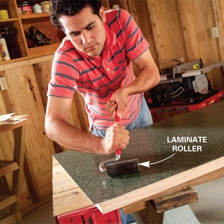 <b>Photo 10: Roll the laminate</b></br> Roll the laminate from the center out to the edges with firm pressure on a roller. If you don't have a roller, wrap a cotton towel around a 10-in. piece of 2x4 and press the laminate down. Go over the entire surface several times and be careful not to break the edges of the laminate as you roll.