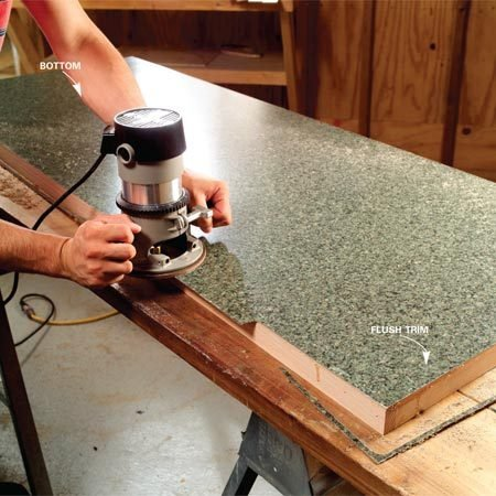<b>Photo 11: Trim the laminate</b></br> Trim the bottom laminate flush with a special flush-trim bit. Go around twice to make sure the edge is crisp. If the bit clogs with glue, unplug the router and clean the bit with WD- 40. Wipe any excess glue off the sides with mineral spirits.