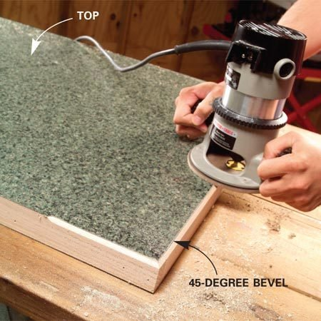 <b>Photo 12: Trim and bevel the top</b></br> Trim the top of the workpiece with a flush trim bit. Then retrim the edges with a 45-degree bevel bit. Practice on a piece of scrap first to test the depth of the bevel cut before trying it out on your workpiece.