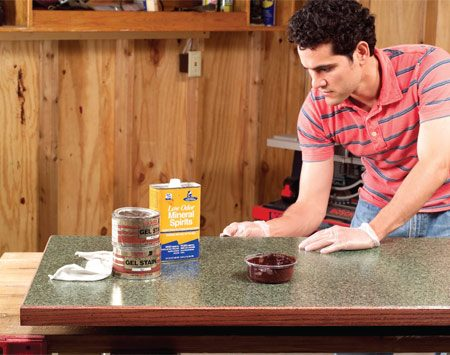 <b>Photo 14: Apply the finish</b></br> Stain the hardwood edge with the oil stain of your choice and wipe any excess off the laminate with a rag dampened with mineral spirits. Once the stain is dry, coat the wood with an oil or varnish.