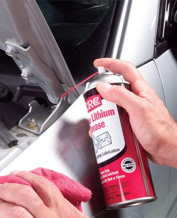 <b>Lubricate hood hinges</b></br> Wipe hinge area then spray with white lithium grease.