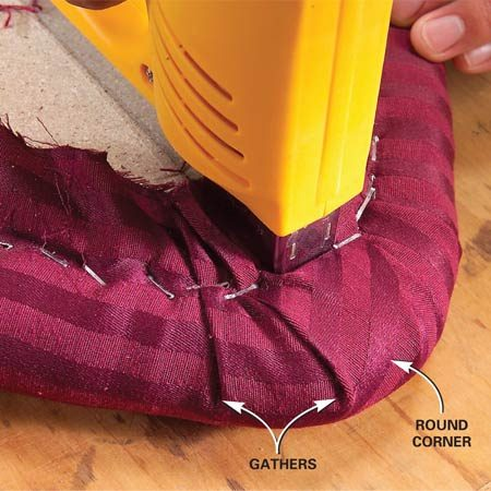 <b>Photo 3: Gather curved corners</b><br/>Create gathers in the fabric to form a smooth curve around curved corners. Work toward the corner from alternating sides. Then pull back the &ldquo;ear&rdquo; of fabric and staple it.