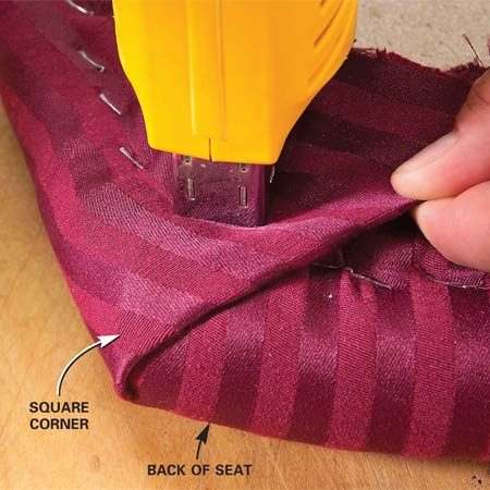 <b>Photo 4: Fold square corners</b><br/>Fold fabric around square corners. If your seat has square corners toward the rear, fold the fabric against the back edge of the seat, where the crease will be hidden by the chair&#39;s back.