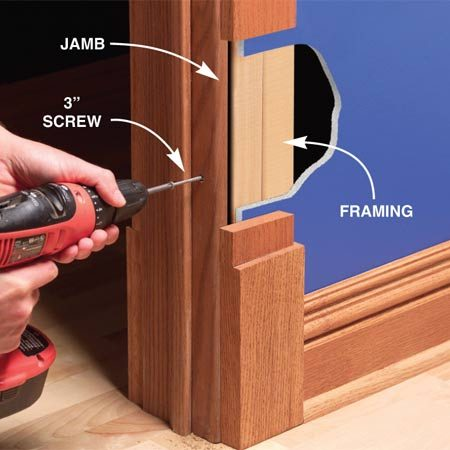 <b>Drill through the jamb</b></br> Predrill a 1/8-in. hole and create a recess for the screwhead with a countersink bit. Then drive a 3-in. screw into the wall framing to draw in the jamb.