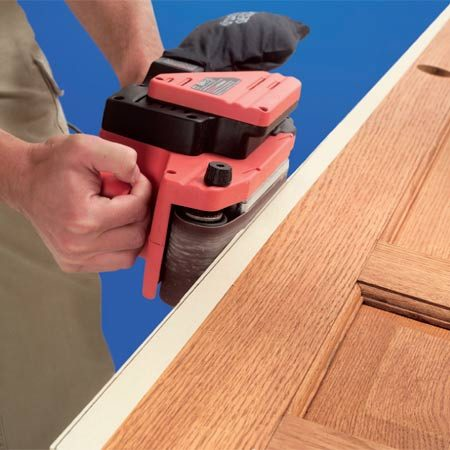 <b>Photo 2: Sand to your mark</b></br> Remove the excess wood with a belt sander. Sand right up to the line, but not into it.