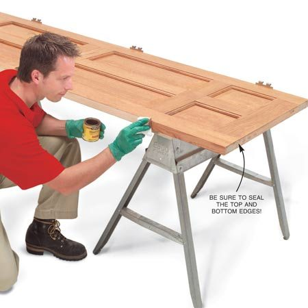 <b>Photo 4: Seal the edge</b></br> Stain or paint the sanded edge. When varnishing the edge, apply polyurethane with a lint-free rag rather than a brush to avoid slopping onto the door's face.