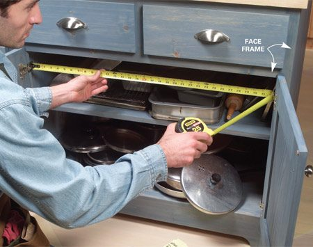 <b>Photo 1: Measure twice</b></br> Open the cabinet doors to their widest point and measure the narrowest part of the cabinet opening (usually at the hinges).