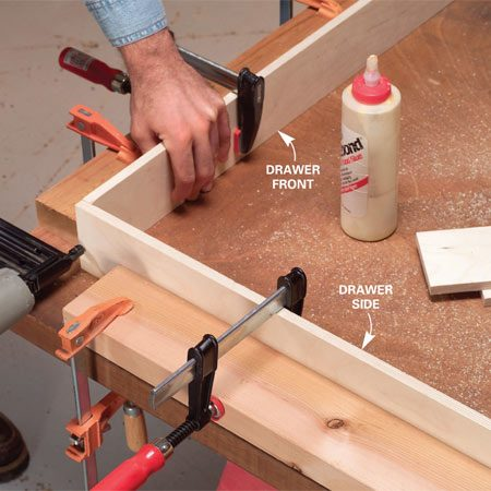 <b>Photo 4: Assemble the sides</b></br> Spread woodworking glue on the ends and clamp a drawer side and front in place, then pin the corner together with three 1-1/4-in. brads. Repeat for the other three corners.
