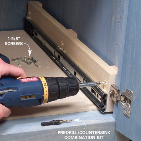 <b>Photo 11: Attach the carrier sides</b></br> Nail the spacers to the center and each end of the carrier sides (not into the cabinet; see next photo). Then predrill and screw the carrier sides to the cabinet in the center of each shim. Slide the drawer back into place.