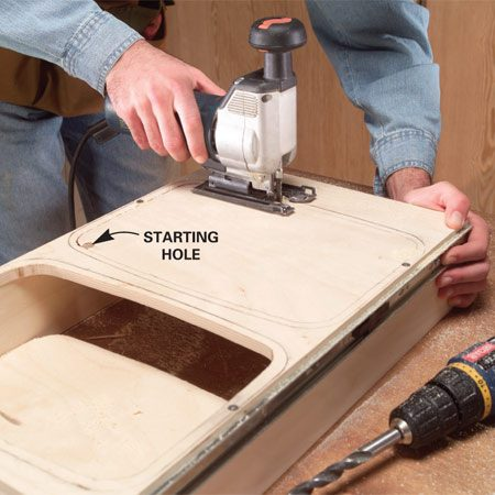 <b>Photo 14: Cut the openings</b></br> Drill 1/2-in. starting holes and cut the openings with a jigsaw.