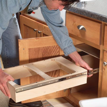 <b>Photo 15: Slide the carrier in</b></br> Mount the wastebasket carrier and drawer as shown in Photos 10 and 11.