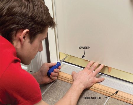 <b>Adjust the sweep</b></br> Lower the sweep until it just blocks out light coming underneath. Then tighten the screws.