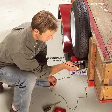 <b>Photo 1: Running a continuity test</b></br> Check the trailer wiring by running a continuity test by connecting a jumper wire to the connector pins and a continuity tester to the sockets.