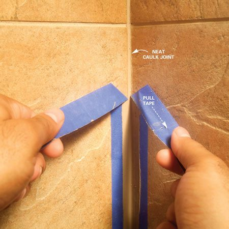 Immediately pull the tape away from the caulk at an<br/> angle as shown.