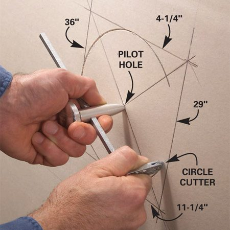 <b>Photo 2: Mark the cutout in the drywall</b></br> Transfer the measurements to the drywall and draw a box. Drive a nail through the center point for a pilot hole. Rotate the cutter several times to score the paper.