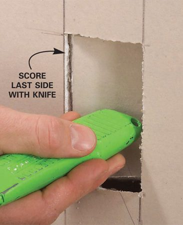 <b>Photo 2: Use a knife to score the fourth side</b></br> Score the fourth side with a utility knife, then snap the flap open with a little punch from the butt end of the knife.