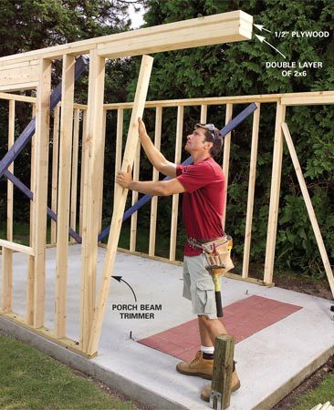<b>Photo 7: Assemble the porch beam</b></br> Create a porch beam with a 1/2-in. plywood filler and two 2x6s screwed to the underside of the extended tie plates. Next cut a 2x4 trimmer to support the beam and fill out each 12-ft. side wall.