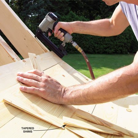 <b>Photo 24: Add shims to match plywood thickness</b></br> Nail shims against the top course of 1x4s to make up the 1/4-in. difference in thickness of the plywood roof sheathing. This will give you a clean transition from the 3/4-in. thick pine boards to the 1/2-in. plywood roof sheathing.