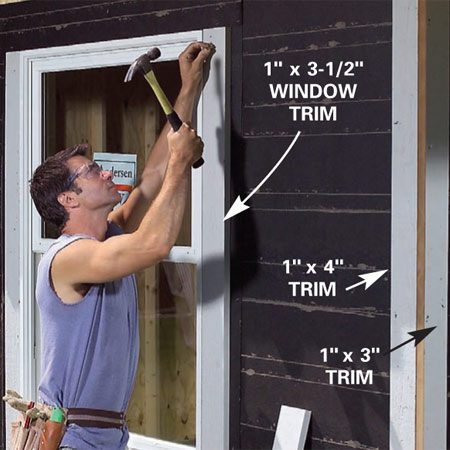 <b>Photo 29: Nail up window, door and corner trim</b></br> Staple No. 15 felt paper to the outside of the sheathing and nail the 1-in. thick corner boards into place, then install your window and door trim.