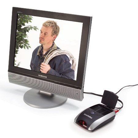 <b>Photo 2: Receiver</b></br> Receives the images from the wireless camera and transmits them to the monitor through wires. The monitor can be a conventional television screen or a computer monitor.
