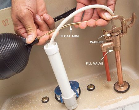 <b>Bend the float arm</b></br> Gently bend the float arm down to put extra pressure on the valve. (To adjust a float that doesn't have an arm, see Photo 8.) Then flush the toilet to see if it works.