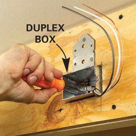 <b>Detail of mounting a duplex box</b></br> Mount a duplex box just above the 2x2 in the soffit facing.