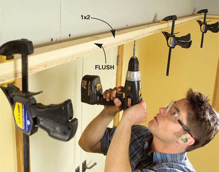 <b>Photo 11: Add the 1x2 nailer</b></br> Clamp and screw a 1x2 nailer flush with the plywood lip using 1-5/8 in. screws. Make sure to overlap plywood seams by at least 1 ft.