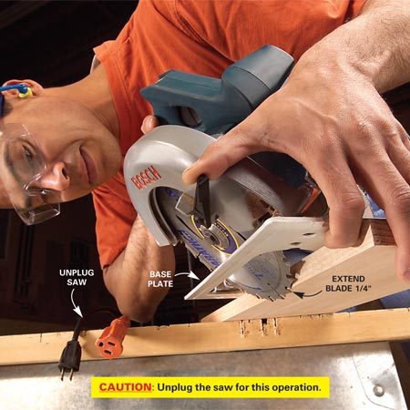 <b>Photo 1: Set depth of cut</b></br> Start by adjusting the depth of cut. Unplug the saw, retract the blade guard and set the saw on your board. Adjust the saw's base plate until the blade extends past the bottom of the board about 1/4 in. Tighten the depth-adjusting lever.