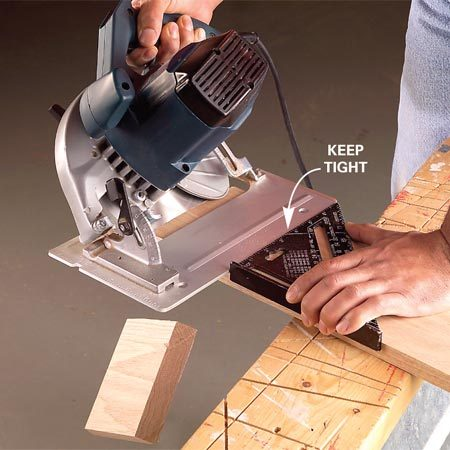 <b>Photo 3: Make the cut</b></br> Keep the saw's base plate tight against the edge and slide the saw through the cut. Let the short cutoff drop free.