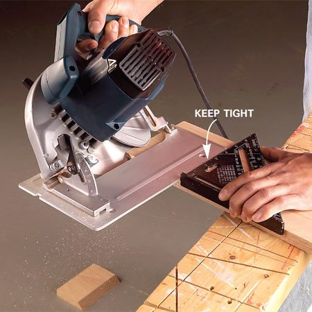 <b>Photo 4: Keep the saw steady</b></br> Maintain firm contact between the back of the saw base plate and the square until the saw blade completely clears the board.
